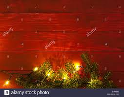 Christmas rustic background - vintage red planked wood with lights ...