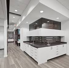 the design office. beautiful office tasios orthodontics  open bay cabinetry sterile behine this looks nice  mainly due to the design and panel behind upper cabinets but i like that  and the design office