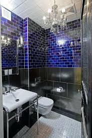 bathroom with chandelier small chandelier is perfect for the compact industrial bathroom design threshold interiors small