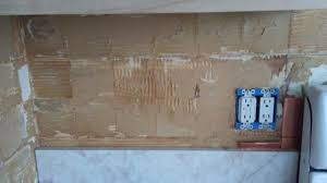 removing tile backsplash attractive walls how to remove metal adhesive from area for 17
