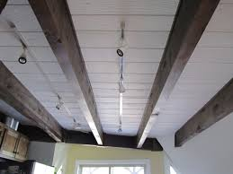 lighting for beamed ceilings. rail lighting on open beam ceiling polizzi kitchen bath ideas pinterest beams and basements for beamed ceilings