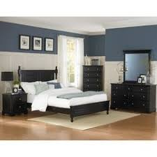 black furniture in bedroom. blue and white bedroom with dark furniture wood floors black in t
