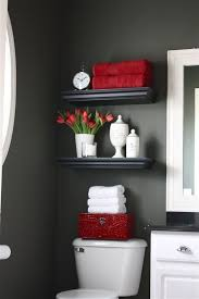 a bathroom with dark walls and red colours