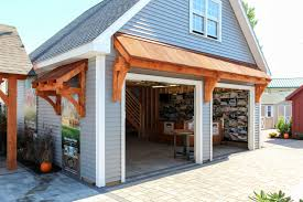 newport garage with timber frame eyebrow roofs
