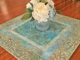 quilted batik table topper with blue