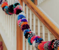 i am so excited to share one of my favorite decorations with you my diy pom pom garland this garland is colorful fun cheery and easy to make