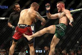 Dustin Poirier closes trilogy with stoppage win after Conor McGregor breaks  his leg in UFC 264 main event - MMA Fighting