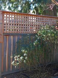 diy privacy fence trellis added to