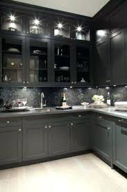 glossy black kitchen cabinets glossy black butlers pantry with glass front kitchen cabinets gray quartz and