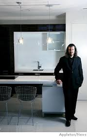 Andres Escobar in a kitchen with Macassar Ebony wood paneling finishes at  The District.