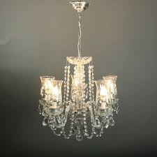 vintage french style chandelier features cut crystal shaft seated on chrome base with five crystal arms