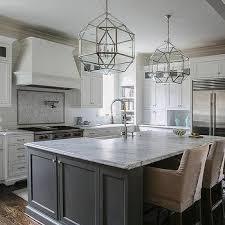 White Kitchen With Grey Island Transitional Kitchen