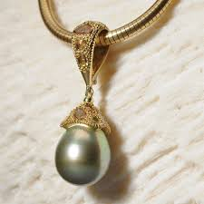 pistachio pearl detachable pendant with 1 7ct rose cut yellow diamonds set in 18kt green gold