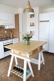 Stool Underneath Diy Alternative Kitchen Island via Wwwikeahackersnet Shelterness 10 Awesome Diy Kitchen Islands From Ikea Items Shelterness