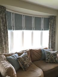 I am often asked how to dress a bow window, here is a great option! Custom  Roman blinds with batons to help support the length and shape and side  panels to ...
