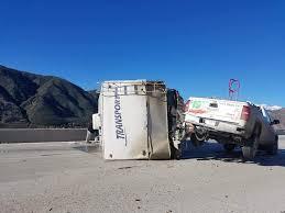 Uhaul truck towing large trailer jackknifed on SB-15 freeway ...