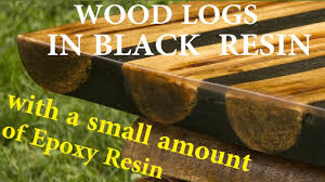 table top black resin and crystal clear resin and wood logs diy