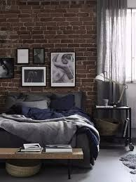 masculine bedroom with simple brick wall