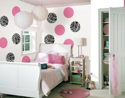 Interior. Girl Bedroom Showing Double White Lantern Over White Wooden Bed  And Circle Pink Zebra