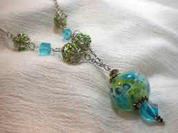 green and blue lampwork pendant necklace still
