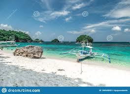 filipino tourist boat in the emerald azure sea on small island background boracay philippines
