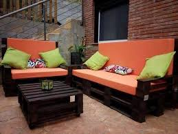 Stained Whole Pallet Sofa with Orange Cushion: