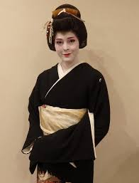 an american geisha in tokyo dressed in kimono and wearing her hair in a traditional