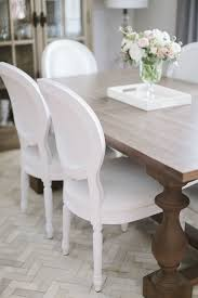 the all white chairs with the dark table love dining room
