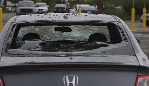a honda damaged by hail is in the wal mart parking lot in helotes after