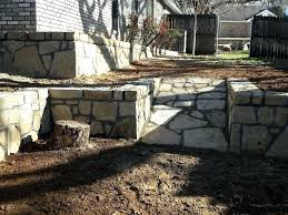 for this gvine homeowner we replaced a retaining wall that was previously built using wooden railroad