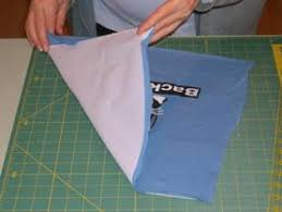 Stabilizing the material is key for t-shirt quilts, find out how! & Now its time to iron the fusible interfacing to the t-shirt fabric. Adamdwight.com