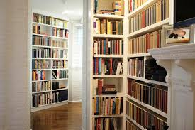 pictures of bookshelves. Custom Bookshelves Wrap The Corner Of This Hallway To Pictures
