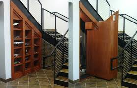 Here's another hidden room under a staircase but instead of rising up to  reveal the room, it opens like a regular door to reveal a hidden area.