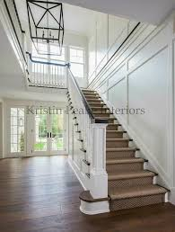 transitional two story foyer features a lantern illuminating a staircase lined with a bound sisal remodel ideas sisal