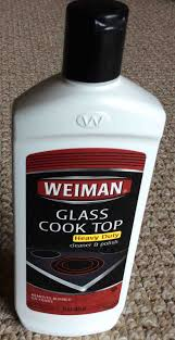picture of the front of a bottle of weiman glass cook top stove cleaner