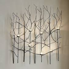 this nature inspired metal wall art candle holder flickers a magical forest of shadowy branches on nature inspired metal wall art with twiggy metal wall candle holder wall candle holders metal walls