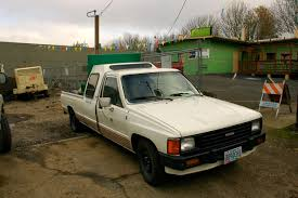 OLD PARKED CARS.: 1986 Toyota Hilux 1 Ton Custom Cab.