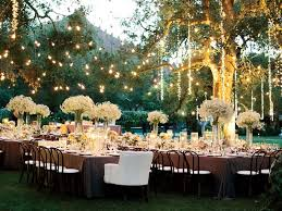 Hanging Lights Over Outdoor Wedding Reception  The Knot