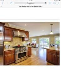 Wonderful Light Hardwood Floors With Dark Cabinets Granite Counter Tops In Concept Ideas