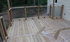 when to stain a new deck what is the