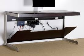 a desk that features magnetically attached front and back panels to conceal unsightly cords and cables