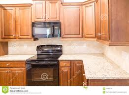 Kitchens With Black Appliances New Kitchen With Granite Countertops And Black Appliances Stock