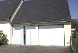 the multi leaf swing garage door fitted with a side door with a 3 point lock