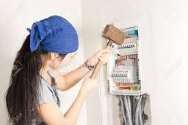 woman taking aim at an electrical fuse box with a large wooden fuse box electrical panel stock photo woman taking aim at an electrical fuse box with a large wooden mallet in an effort to solve her supply problems