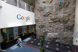 office of google. an interior view of office space with indoor climbing wall at the googleplex google u
