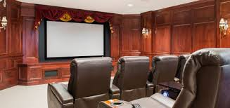 home theater system room. room lighting is controlled, as well, in order to ensure the best picture delivery from a high-definition, properly calibrated projector. home theater system
