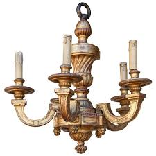 gilt hand carved five arm wooden chandelier at 1stdibs