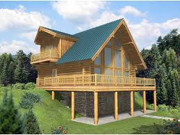 raised a frame log home perfect for a sloping lot