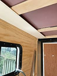 2 tongue and groove wood planks installed on rv ceiling