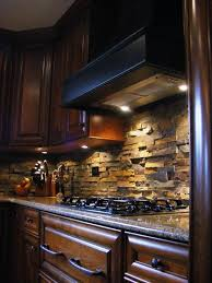 backsplash lighting. naturalstone kitchen backsplash tiles types dark wood cabinets recessed lighting l